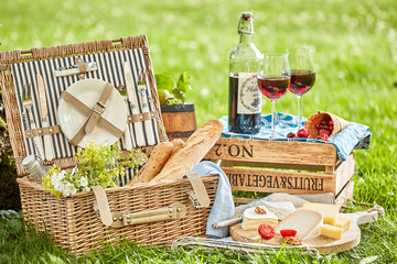 Picnic outside with a basket and delicious food