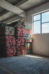 Warehouse With Stacked Wood In The Furniture Factory