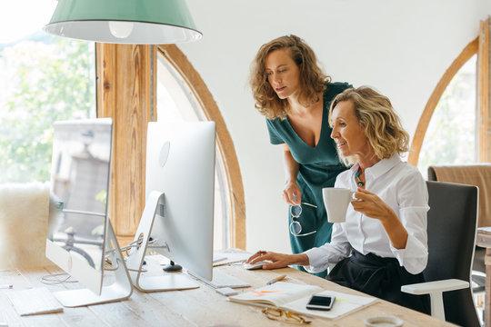 Businesswomen working in a modern office.