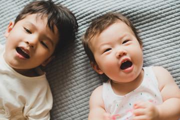 Happy siblings looking at camera