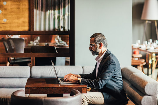 Businessman Typing on His Laptop