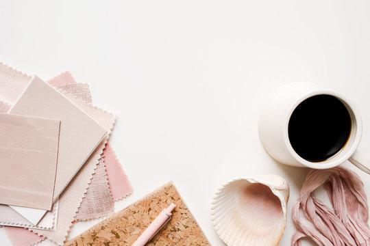 over an interior designer's desk working with blush pink