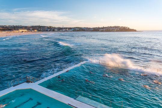 People swimming in pool at ocean, Bondi Beach, Sydney