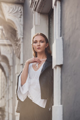 Stylish young woman portrait in european city