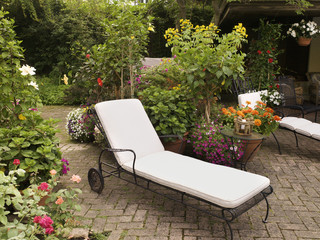 Private Patio and Garden of Home with Lounge Chair and Towels, Toronto, Ontario, Canada