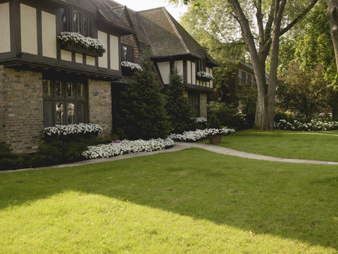 View of house exterior and front garden in summer, Toronto, Ontario, Canada