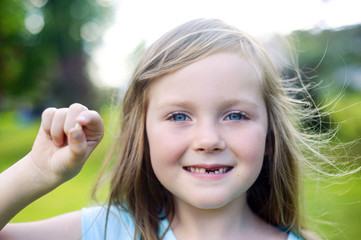 Girl Proudly Showing off after Losing her Front Tooth, Moncton, New Brunswick, Canada