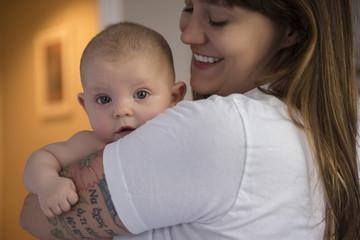portrait of baby over mother's shoulder