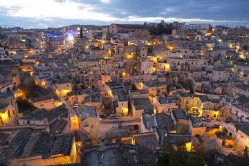Overview of Sassi di Matera at dusk, one of the three oldest cities in the world, Matera, Basilicata, Italy