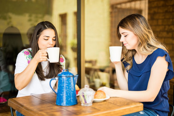 Two women having coffee together