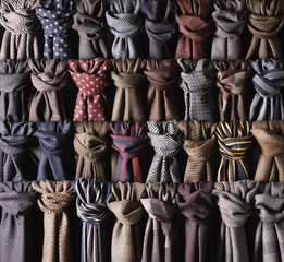 Close-up of rows of coloured and knotted scarves