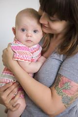 mother hugging infant