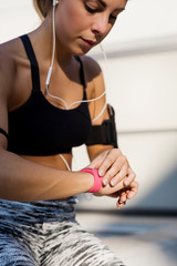Sporty woman looking at a chronometer