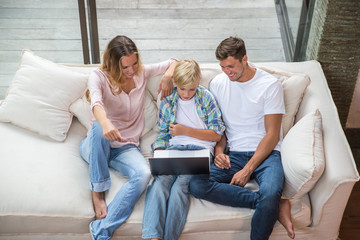 Family watching movie on a laptop