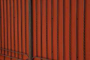 red black metal texture from an iron fence and steel rods