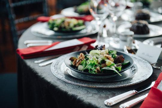 Elegant event setup with appetizer salad