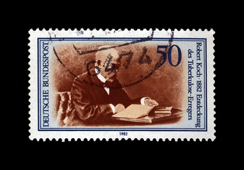 Robert Koch (1843-1910), tuberculosis scientist, explorer, tubercle bacillus discoverer, circa 1982. vintage post stamp printed in Germany isolated on black background.