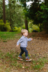 Young Boy Walking in Park