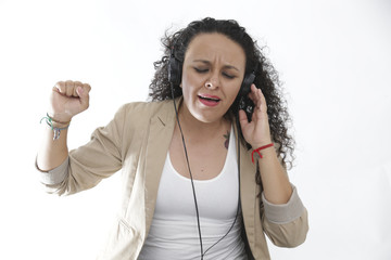 girl using headphones and listening music