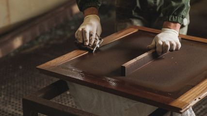Man In The Uniform Working At The Furniture Factory