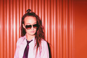 Beautiful young woman with black tie and sunglasses
