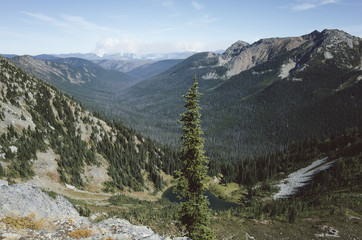 Vast mountains and valley, Hopkins Lake in distance and wildfire in distance, Pasayten Wilderness, Washington