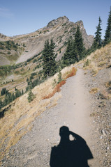 Shadow of hiker taking photos along the Pacific Crest Trail, Pasayten Wilderness, Washington