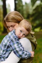 Little Boy Cuddling with Mom