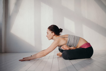 Inspired woman relaxing in yoga pose