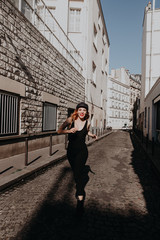 woman smiling and running through streets of paris