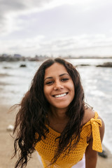 Portrait of a beautiful mixed race woman on the beach