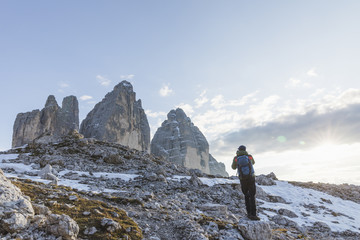 Man photographing the Three Peaks of Lavaredo, Dolomites