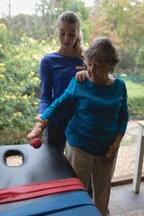 Physiotherapist assisting a senior woman with physiotherapy