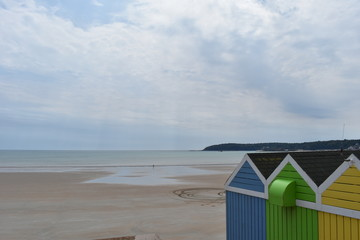 Colourful beach huts on Jersey island, England, July, 2018