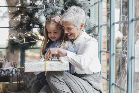 Grandmother Giving Christmas Present to Her Grandchild