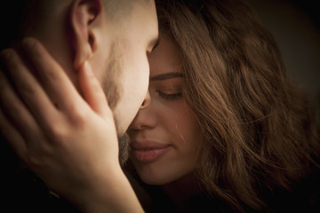 Portrait of emotional young couple in love hugging each other. (happiness, love, romance, sensuality concept)