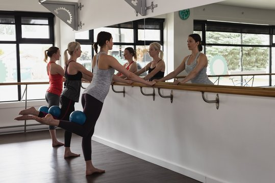 Group of women stretching on the barre