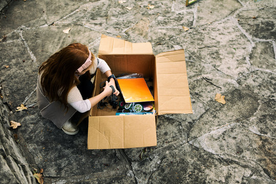 Sukkot: Girl Looks Through Box For Straps For Walls