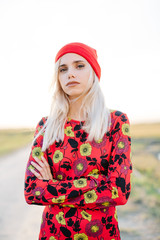 Beautiful girl on field in autumn