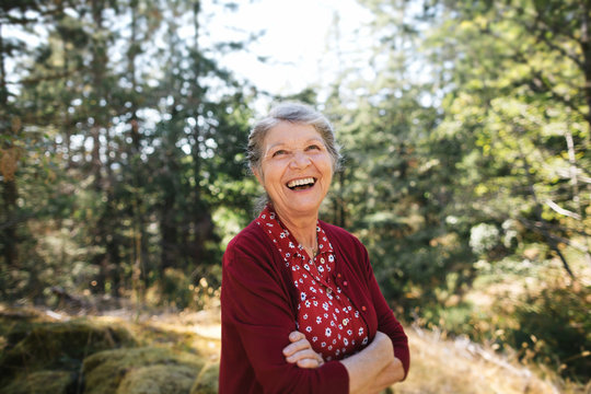 Mature woman with silver hair outside in nature