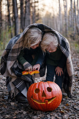 Kids playing with Halloween pumpkin