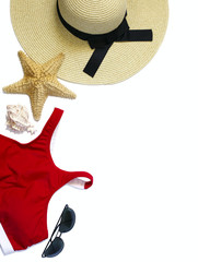 Women's swimsuit, straw hat, sunglasses and seashells isolated on white background. Flat lay composition of summer fashion