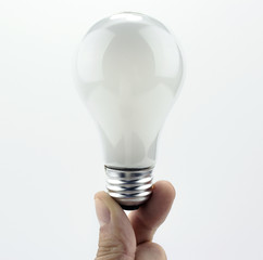 Light bulb held with two fingers