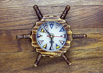A maritime themed wooden clock