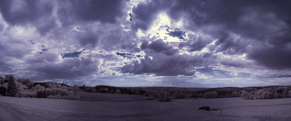 infrared photography - ir photo of landscape under sky with clouds - the art of our world in the infrared camera spectrum
