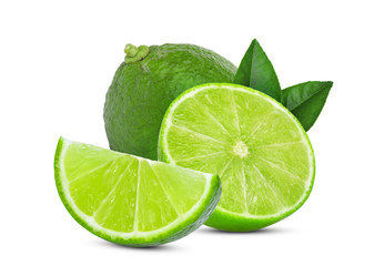 whole and slice green lime with green leaves isolated on white background