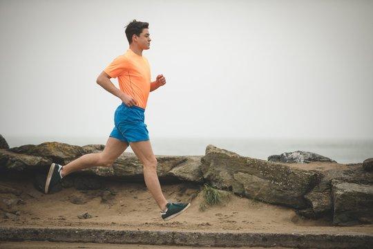 Man jogging on he sea shore