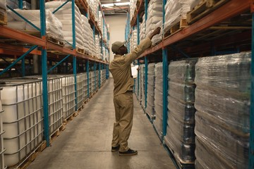 Worker checking stocks in warehouse