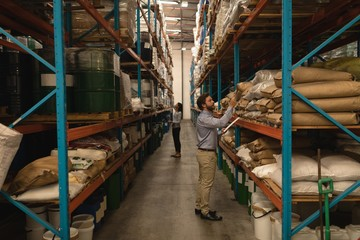 Staff checking stocks in warehouse