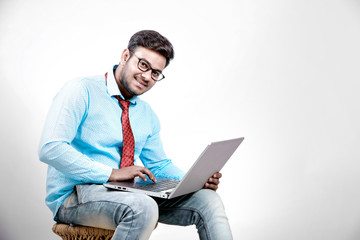 Young indian male using laptop